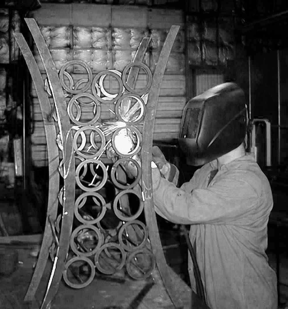 Darren welding on Chamber wine rack-grayscale-cropped-9-29-03